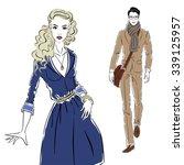 girl in a blue dress meets man... | Shutterstock .eps vector #339125957
