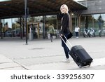 smiling young woman traveling... | Shutterstock . vector #339256307