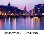 Stock photo pink sunset in amsterdam netherlands 339315053