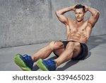 male fitness model doing sit... | Shutterstock . vector #339465023