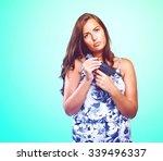 pensive woman holding a gun | Shutterstock . vector #339496337