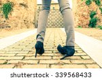 woman walking on high heeled... | Shutterstock . vector #339568433