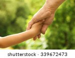 the parent holds the hand of a... | Shutterstock . vector #339672473