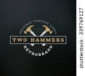 crossed hammers. vintage retro... | Shutterstock .eps vector #339769127