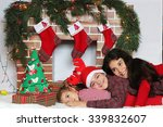 three smiling children lying... | Shutterstock . vector #339832607