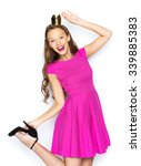 Small photo of people, holidays and fashion concept - happy young woman or teen girl in pink dress and princess crown