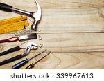 assorted work tools on wood | Shutterstock . vector #339967613