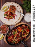 pork fajitas with onions and... | Shutterstock . vector #340081187