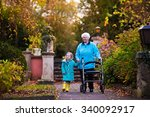 happy senior lady with a walker ... | Shutterstock . vector #340092917