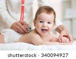 pediatrician doctor examines... | Shutterstock . vector #340094927