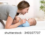 happy mother playing with baby... | Shutterstock . vector #340107737