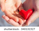 hands of man and woman holding... | Shutterstock . vector #340131527
