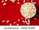 bowl with popcorn on red... | Shutterstock . vector #340176383
