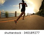 young fitness woman running on... | Shutterstock . vector #340189277