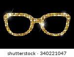Golden Glasses On Black...