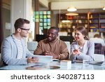 happy employees discussing data ... | Shutterstock . vector #340287113