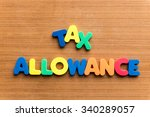 Small photo of tax allowance colorful word on the wooden background