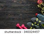 sport fitness items on dark... | Shutterstock . vector #340324457