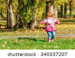 girl playing in the park with a ... | Shutterstock . vector #340337207
