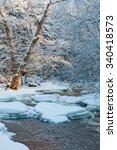 Open Water In Wintry River...