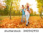 mother and father carry little... | Shutterstock . vector #340542953