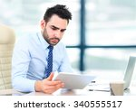 handsome businessman working... | Shutterstock . vector #340555517