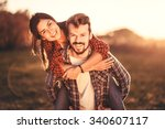 loving couple hugging outdoors... | Shutterstock . vector #340607117
