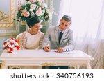 bride and groom signing... | Shutterstock . vector #340756193