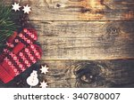 red mittens on wooden background | Shutterstock . vector #340780007