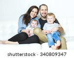 a young happy family with two... | Shutterstock . vector #340809347