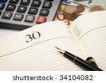 euro bills pen and notebook... | Shutterstock . vector #34104082