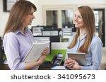 two businesswomen having... | Shutterstock . vector #341095673