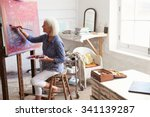 female artist working on... | Shutterstock . vector #341139287