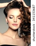 model with long hair. waves... | Shutterstock . vector #341153687