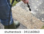 man washing concrete path with... | Shutterstock . vector #341160863