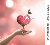 Small photo of White ribbon on red love heart tree with butterfly on woman's hands on blurred abstract background of orange autumn leaves: International Day for the Elimination of Violence against Women concept
