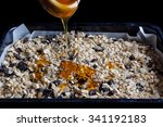 granola in a black baking tray... | Shutterstock . vector #341192183