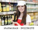 smiling supermarket employee... | Shutterstock . vector #341236193