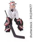 Small photo of A young teen hockey goaler in studio white background