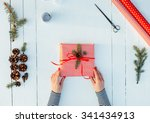 Present Wrapped In Red Paper O...