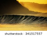 Wave Breaking On Sea At Sunset...