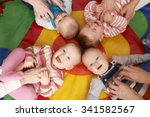 Overhead View Of Babies Having...