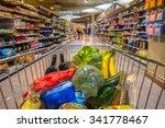 grocery cart at a supermarket... | Shutterstock . vector #341778467