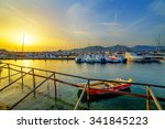 a sunset over the port in... | Shutterstock . vector #341845223