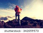 young woman backpacker hiking... | Shutterstock . vector #342059573