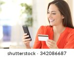Lady Buying Online With A...