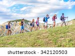 Group Of Hikers Walking In The...