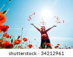 girl stands in poppy field | Shutterstock . vector #34212961