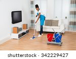 Young Woman Cleaning Floor Wit...