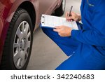 young mechanic writing on... | Shutterstock . vector #342240683